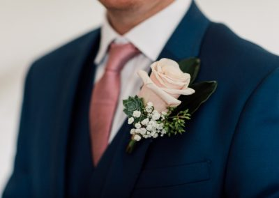 Buttonhole pink rose with succulent